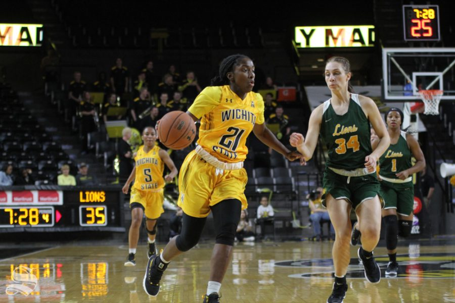 Junior guard Maya Brewer charges toward the goal during the Nov. exhibition game.