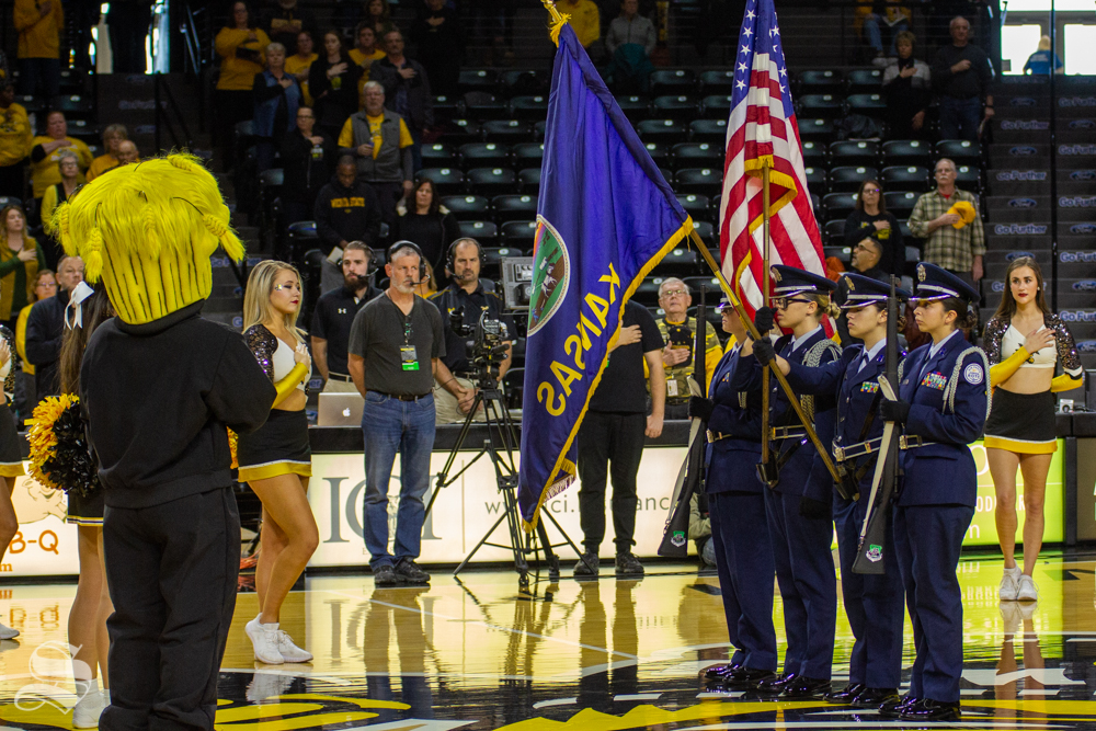 Wu looks to the flag during the national anthem at WSU's game against Missouri State on Nov. 10, 2018 in Koch arena.