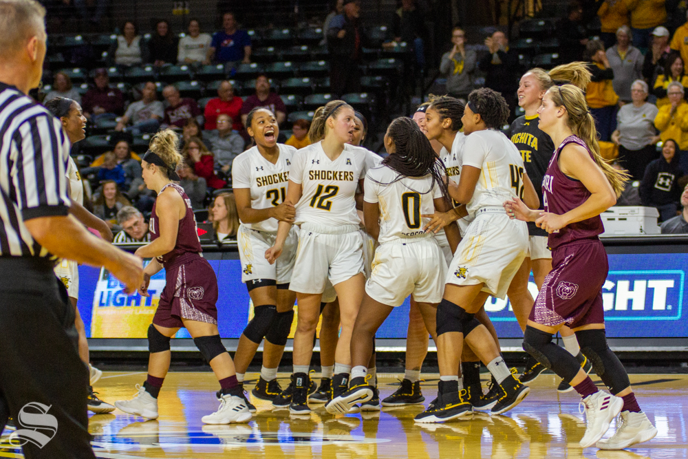 Wichita State team members celebrate after Carla Bremaud ties the game against Missouri State on November 10 in Charles Koch Arena.