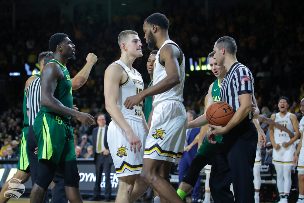 Wichita State forward Markis McDuffie celebrates with freshman Erik Stevenson during their game against Baylor in Charles Koch Arena on Dec. 1, 2018.