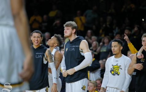 Wichita State center Asbjørn Midtgaard celebrates on the bench during their game against Baylor in Charles Koch Arena on Dec. 1, 2018.