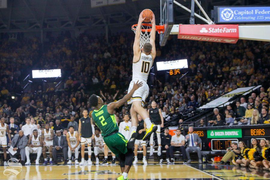 Wichita+State+freshman+Erik+Stevenson+makes+a+dunk+over+Baylor+guard+Devonte+Bandoo+on+Dec.+1%2C+2018+in+Koch+Arena.