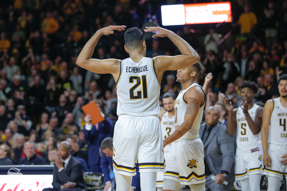 Wichita State forward Jaime Echenique raises his hands to the fans during their game against Baylor on Dec. 1, 2018 in Charles Koch Arena.