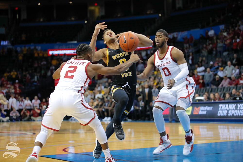 Wichita State guard Dexter Dennis gets fouled during their game against the University of Oklahoma at Chesapeake Energy Arena in Oklahoma City on Dec. 8, 2018.