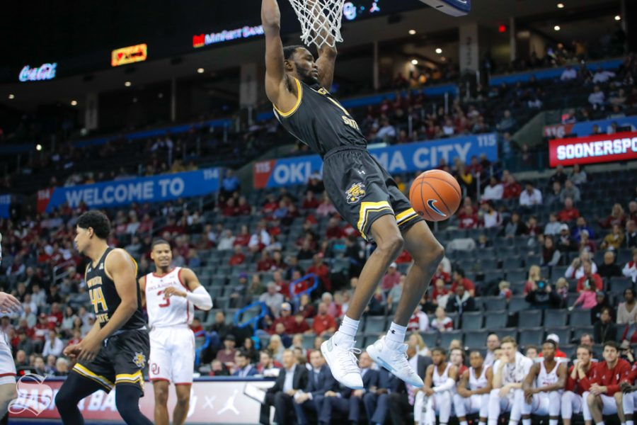 Wichita+State+senior+Markis+McDuffie+hangs+on+the+rim+after+a+dunk+during+their+game+against+the+University+of+Oklahoma+at+Chesapeake+Energy+Arena+in+Oklahoma+City+on+Dec.+8%2C+2018.