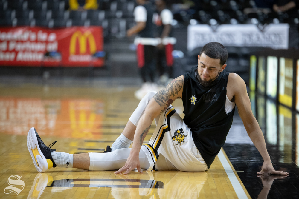 Wichita State guard Ricky Torres stretches before their game against Jacksonville State on Dec. 12, 2018 at Charles Koch Arena. (Joseph Barringhaus/The Sunflower)