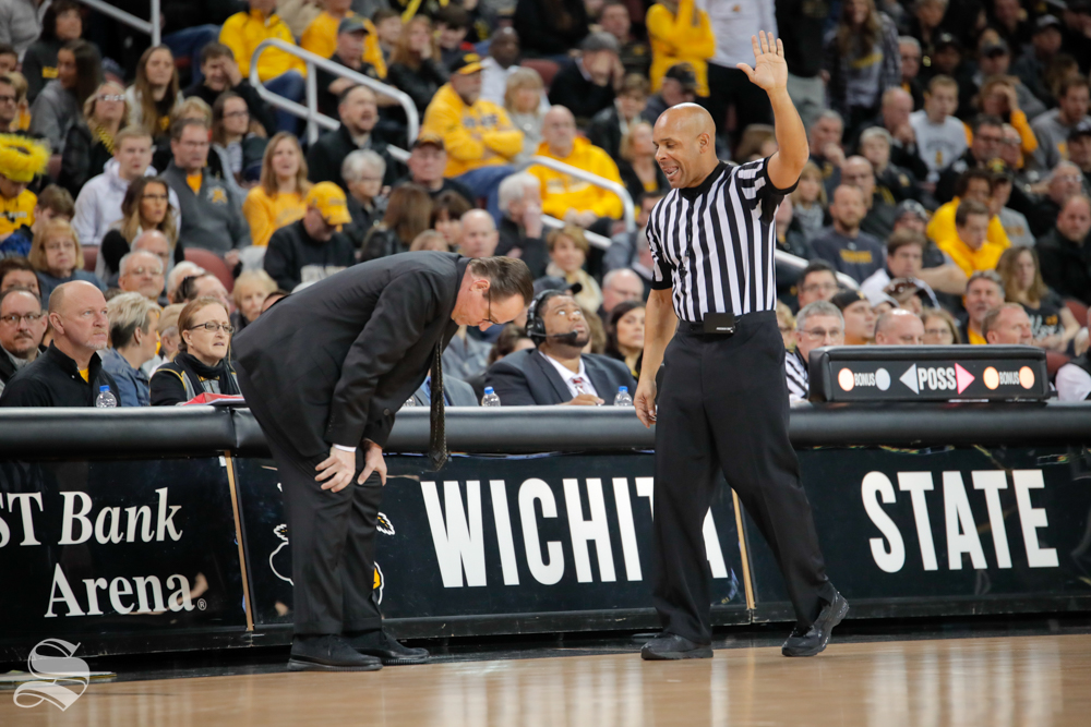 Head Coach Gregg Marshall bends over after a call is made against Wichita State during their game against Southern Miss on Dec. 15, 2018 at INTRUST Bank Arena.