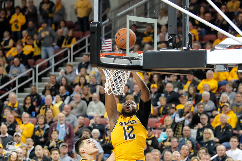 Wichita State freshman Morris Udeze dunks the ball during their game on Dec. 15, 2018 at INTRUST Bank Arena.