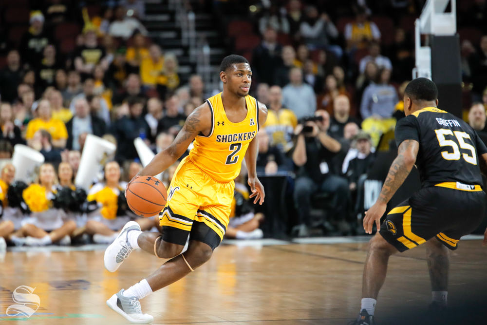 Wichita State guard Jamarius Burton dribbles past half court during their game against Southern Miss on Dec. 15, 2018 at INTRUST Bank Arena.