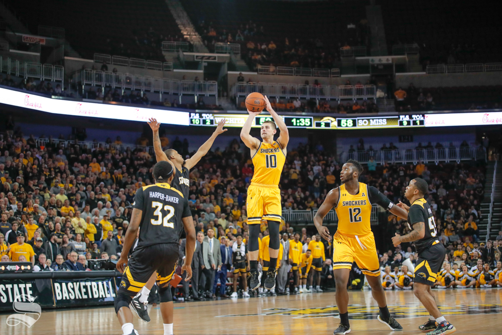 Wichita State guard Erik Stevenson takes a shot during their game against Southern Miss on Dec. 15, 2018 at INTRUST Bank Arena.