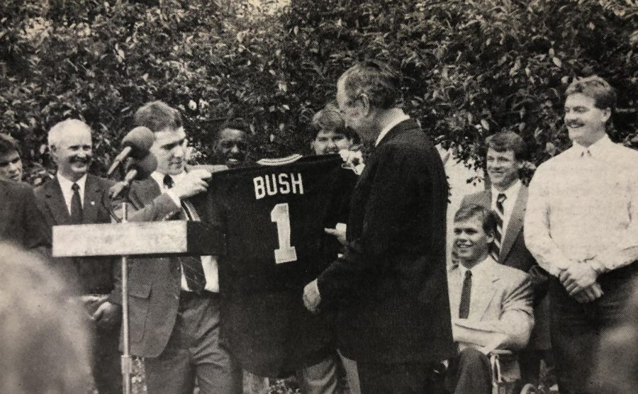 President+George+H.W.+Bush+receives+his+own+Shocker+jersey+from+Wichita+State%27s+Greg+Brummett.
