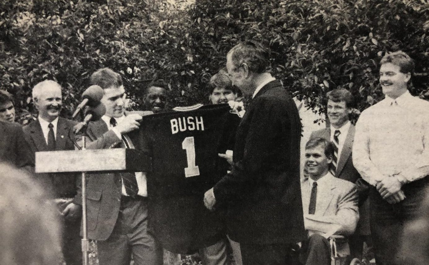 President George H.W. Bush receives his own Shocker jersey from Wichita State's Greg Brummett.