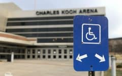 Fans who typically use disability parking spots outside of Charles Koch Arena had to choose to either pay $10 to park their vehicle or walk in the cold, wintery rain Saturday night.