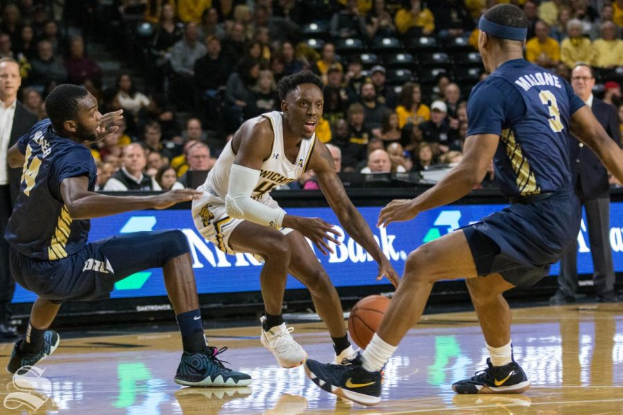 Wichita+State+senior+Samajae+Haynes-Jones+attempts+to+drive+past+Oral+Roberts+defenders+during+the+game+at+Koch+Arena+Wednesday%2C+Dec.+19%2C+2018.