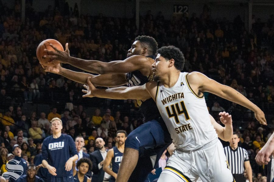 Wichita State's Isaiah Poor Bear-Chandler reaches for a rebound during the game against Oral Roberts at Koch Arena Wednesday, Dec. 19, 2018.