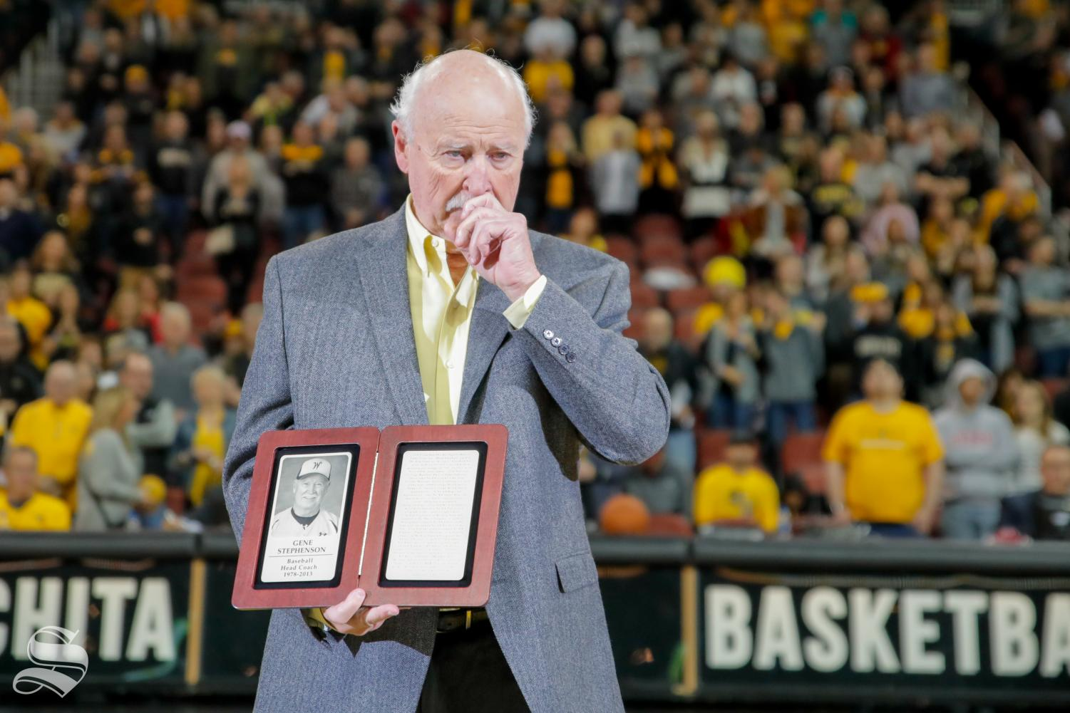 Ex-Wichita State baseball coach Gene Stephenson holds back tears. Wichita State inducted Stephenson into the Hall of Fame on Saturday. Stephenson led Wichita State to seven College World Series appearances, and in 1989, WSU won the College World Series.