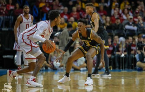 Wichita State's Samajae Haynes-Jones defends Oklahoma guard Jamal Bieniemy.