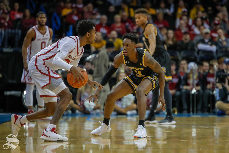 Wichita State's Samajae Haynes-Jones defends Oklahoma guard Jamal Bieniemy.