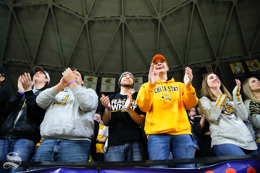 Fans cheer during the game against Cincinnati on Jan. 19, 2019 at Charles Koch Arena. (Photo by Joseph Barringhaus/The Sunflower).