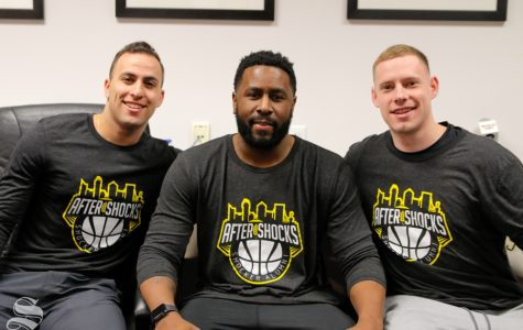 Wichita State alumni John Robert Simon (left) and Zach Bush (right) pose with the AfterShocks coach, Karon Bradley (middle).