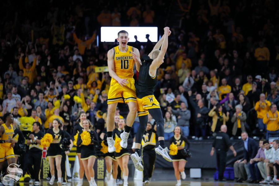 Wichita+State+freshman+Erik+Stevenson+and+sophomore+Brycen+Bush+celebrate+at+center+court+after+beating+SMU+on+Jan.+30%2C+2019+at+Charles+Koch+Arena.+%28Photo+by+Joseph+Barringhaus%2FThe+Sunflower%29.