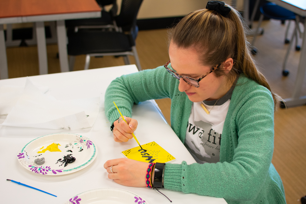 Graduate audiology student, Shayla Ingalls, applies finishing touches to a ceramic tile during an event held in the RSC on Wednesday, January 30. The event was held by Student Affairs to help students reflect on various aspects of their academics.