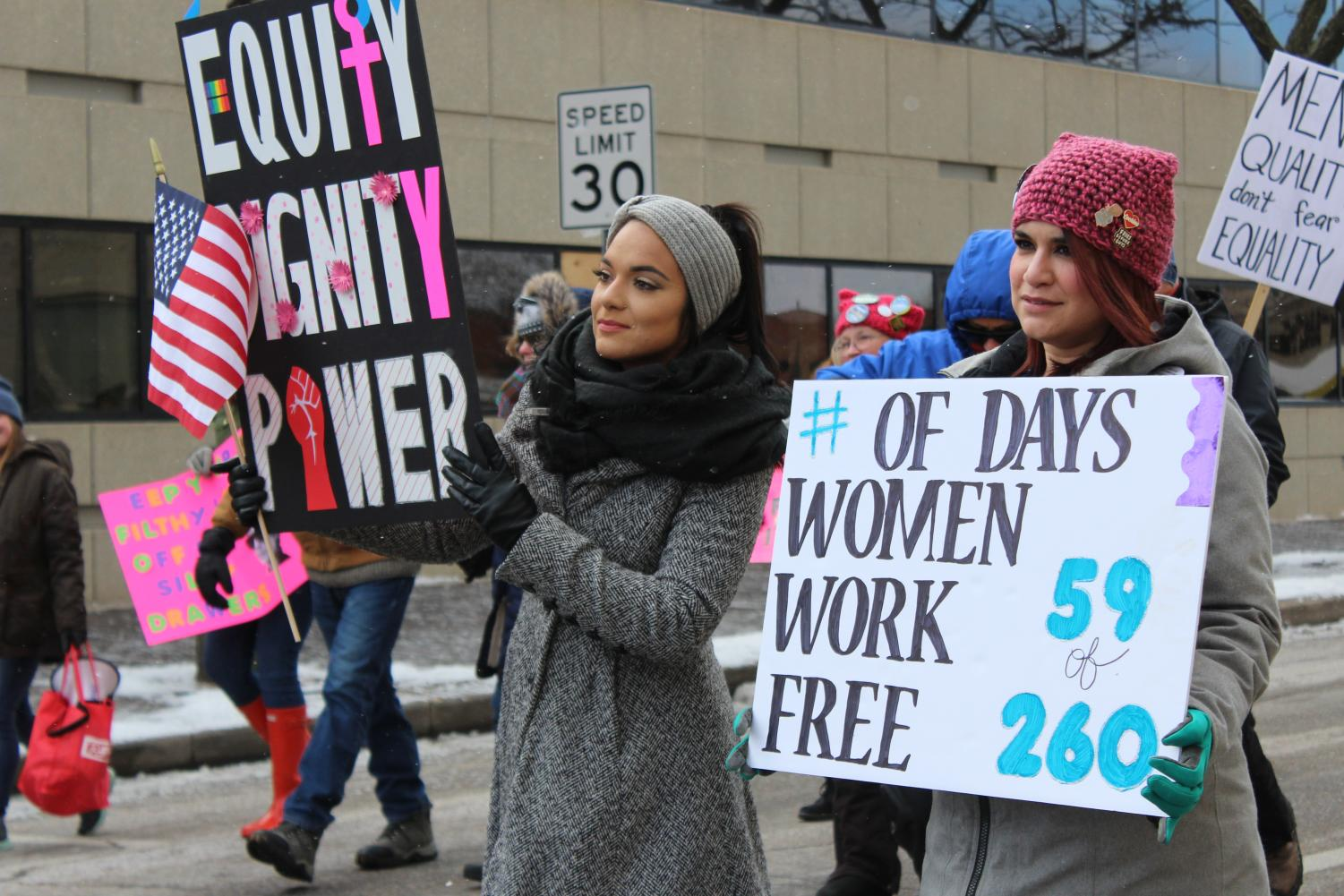 4) Women matched in Wichita for the third annual Women's March - Air Capital. Luisa Taylor (right) spoke at the rally after the march.