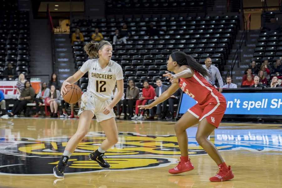 Wichita+State+freshman+Carla+Bremaud+crosses+a+defender+over+during+their+game+against+Houston+on+Jan.+20%2C+2019+at+Koch+Arena.