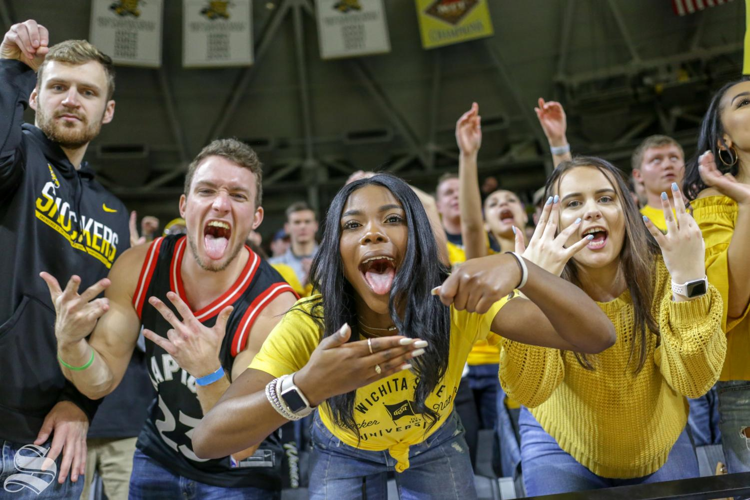 Wichita State fans celebrate a step-back jumper made by WSU senior Samajae Haynes-Jones with 22 seconds left in the game held on Jan. 16 at Charles Koch Arena. The two-point jumper by Haynes-Jones secured the victory against Central Florida.