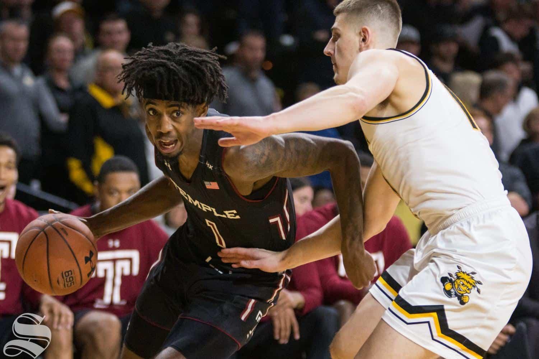 Temple's Quinton Rose moves past Wichita State's Erik Stevenson.
