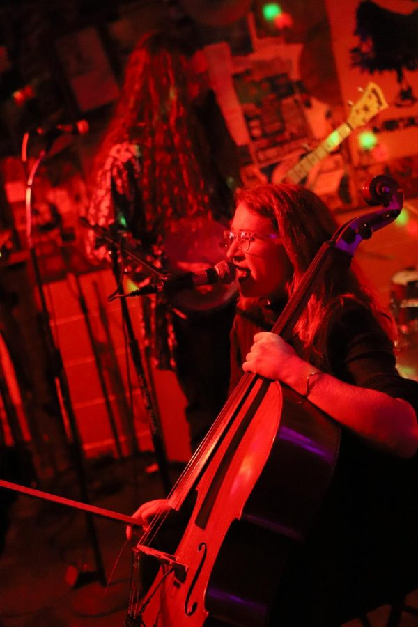 Preexisting Conniptions cellist Roni Worcester rips through a song during the bands set Saturday night.