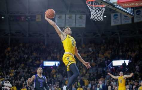 Wichita State freshman Dexter Dennis dunks the ball in the final seconds of the game against Tulsa on Feb. 2, 2019 at Charles Koch Arena. (Photo by Joseph Barringhaus/The Sunflower).