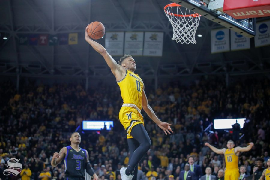 Wichita+State+freshman+Dexter+Dennis+dunks+the+ball+in+the+final+seconds+of+the+game+against+Tulsa+on+Feb.+2%2C+2019+at+Charles+Koch+Arena.+%28Photo+by+Joseph+Barringhaus%2FThe+Sunflower%29.