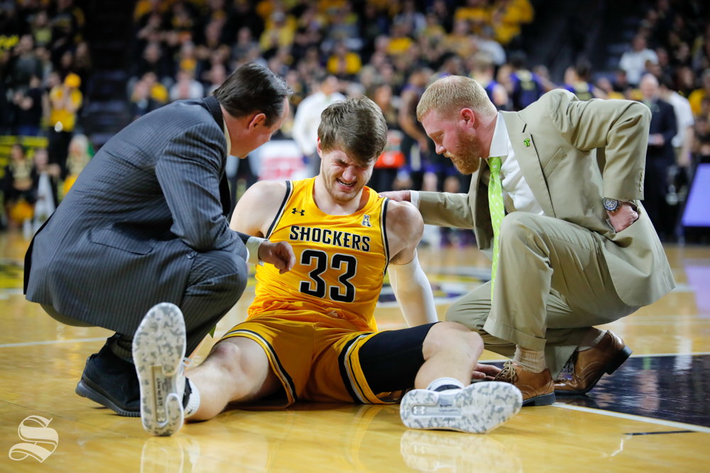 Wichita State center Asbjørn Midtgaard sits on the ground after getting elbowed in the face during the game against Tulsa on Feb. 2, 2019 at Charles Koch Arena. Midtgaard didn't return to the game. (Photo by Joseph Barringhaus/The Sunflower).