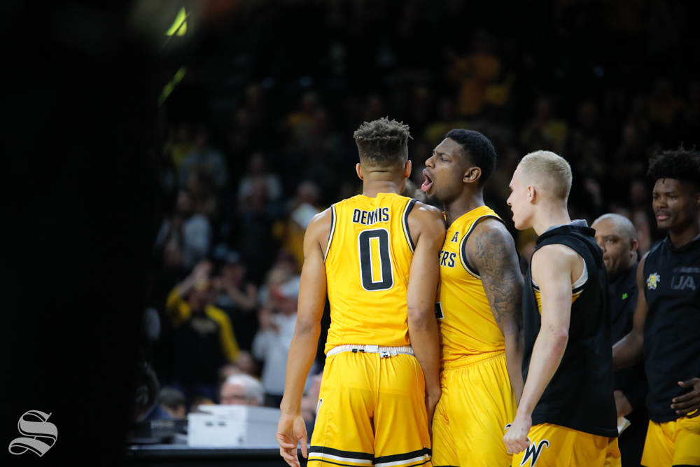 Wichita State guard Jamarius Burton yells towards guard Dexter Dennis after a point is scored during the game against Tulsa on Feb. 2, 2019 at Charles Koch Arena. (Photo by Joseph Barringhaus/The Sunflower).