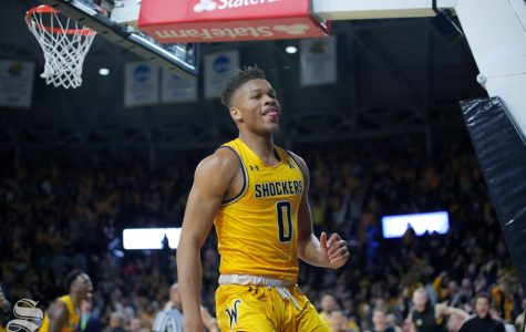 Wichita State freshman Dexter Dennis celebrates after dunking the ball in the final seconds of the game against Tulsa on Feb. 2, 2019 at Charles Koch Arena. (Photo by Joseph Barringhaus/The Sunflower).