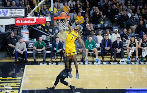 Wichita State forward Markis McDuffie slams it down over a Tulane defender in the first half of the game against Tulane on Feb. 9, 2019 at Charles Koch Arena. (Photo by Joseph Barringhaus/The Sunflower).
