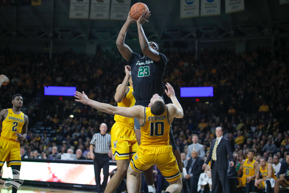 Tulane+forward+Blake+Paul+fouls+Wichita+State+guard+Erik+Stevenson+on+his+way+to+the+baskt+during+the+first+half+of+the+game+on+Feb.+9%2C+2019+at+Charles+Koch+Arena.+%28Photo+by+Joseph+Barringhaus%2FThe+Sunflower%29.