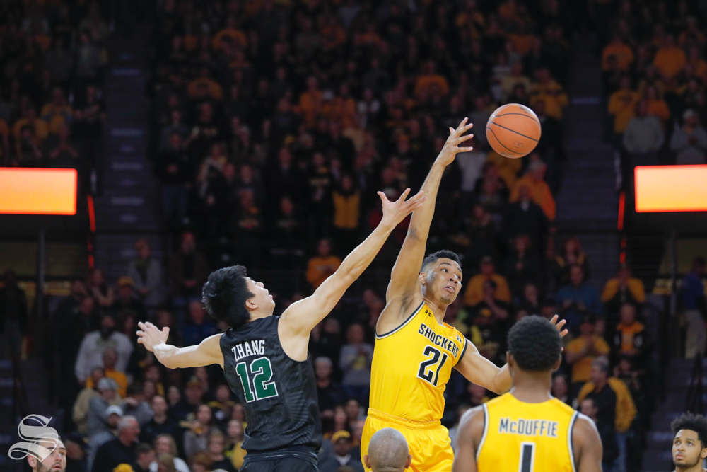 Wichita+State+forward+Jaime+Echenique+wins+the+tip+against+Tulane+guard+Kevin+Zhang+during+the+game+against+Tulane+on+Feb.+9%2C+2019+at+Charles+Koch+Arena.+%28Photo+by+Joseph+Barringhaus%2FThe+Sunflower%29.