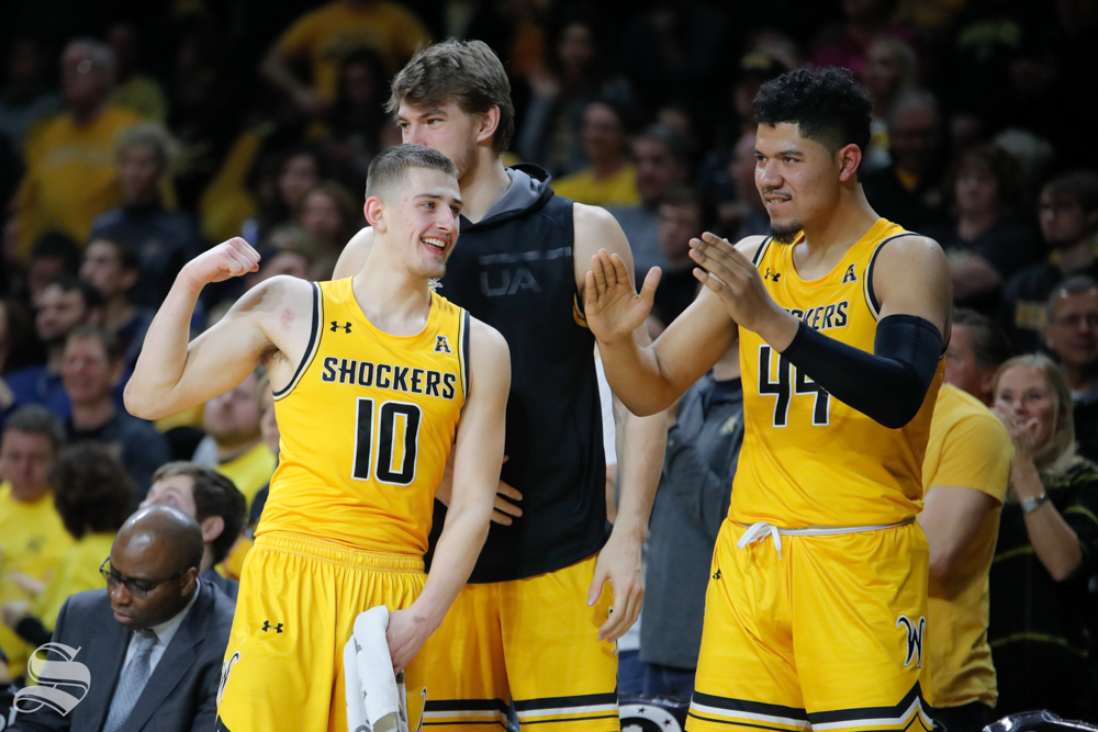 Wichita State freshman Erik Stevenson and forward Isaiah Poor Bear-Chandler celebrate after a basket is made during the game against Tulane on Feb. 9, 2019 at Charles Koch Arena. (Photo by Joseph Barringhaus/The Sunflower).
