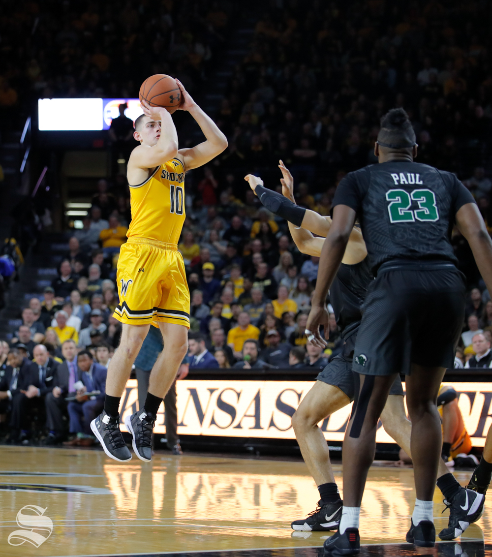 Wichita+State+freshman+Erik+Stevenson+take+a+shot+during+the+game+against+Tulane+on+Feb.+9%2C+2019+at+Charles+Koch+Arena.+Stevenson+played+27+minutes+in+their+win+over+Tulane.+%28Photo+by+Joseph+Barringhaus%2FThe+Sunflower%29.