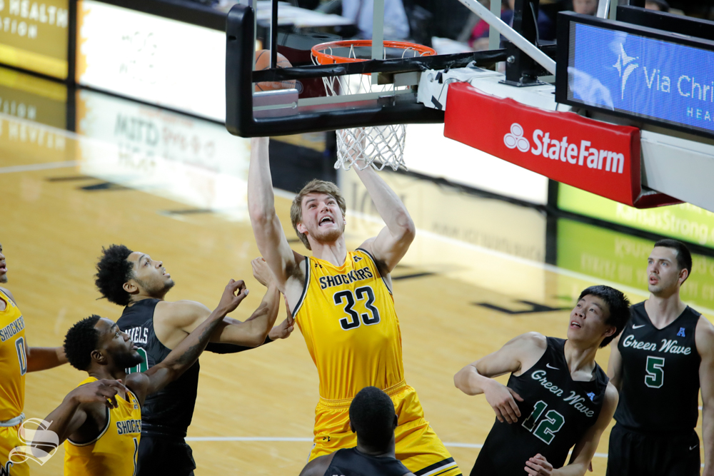 Wichita+State+center+Asbj%C3%B8rn+Midtgaard+goes+up+for+a+basket+during+the+game+against+Tulane+on+Feb.+9%2C+2019+at+Charles+Koch+Arena.+After+a+late+third+foul+in+the+first+half%2C+Midtgaard+didn%27t+return+for+the+rest+of+the+game.+%28Photo+by+Joseph+Barringhaus%2FThe+Sunflower%29.