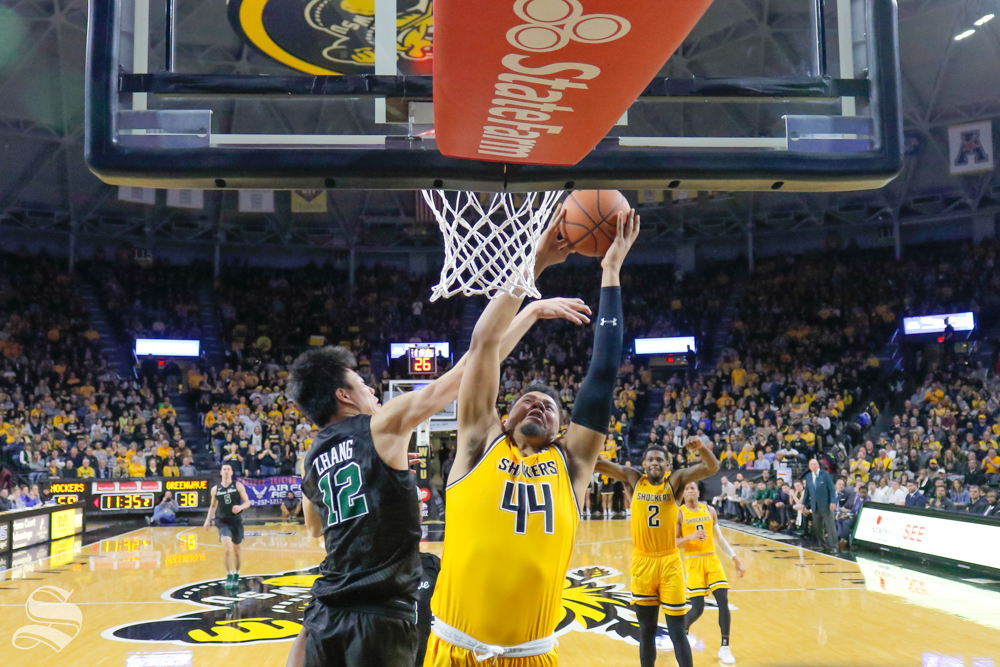 Wichita+State+forward+Isaiah+Poor+Bear-Chandler+goes+up+against+Tulane+guard+Kevin+Zhang+on+Feb.+9%2C+2019+at+Charles+Koch+Arena.+%28Photo+by+Joseph+Barringhaus%2FThe+Sunflower%29.
