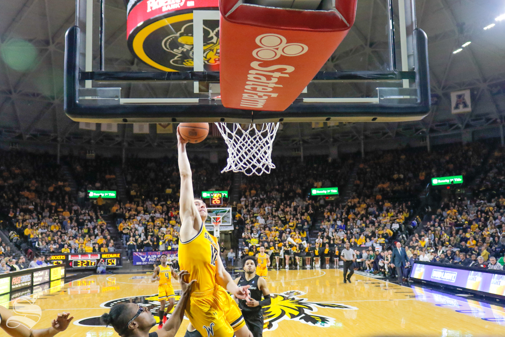 Wichita+State+guard+Erik+Stevenson+goes+up+for+a+dunk+during+the+game+against+Tulane+on+Feb.+9%2C+2019+at+Charles+Koch+Arena.+Stevenson+missed+the+dunk+but+was+fouled+in+the+process.+%28Photo+by+Joseph+Barringhaus%2FThe+Sunflower%29.