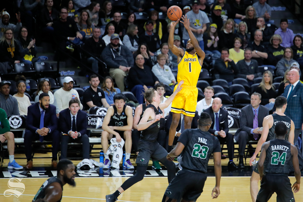 Wichita+State+forward+Markis+McDuffie+takes+a+three-point+basket+during+the+game+against+Tulane+on+Feb.+9%2C+2019+at+Charles+Koch+Arena.+McDuffie+led+the+team+with+25+points+in+their+win+against+Tulane.+%28Photo+by+Joseph+Barringhaus%2FThe+Sunflower%29.