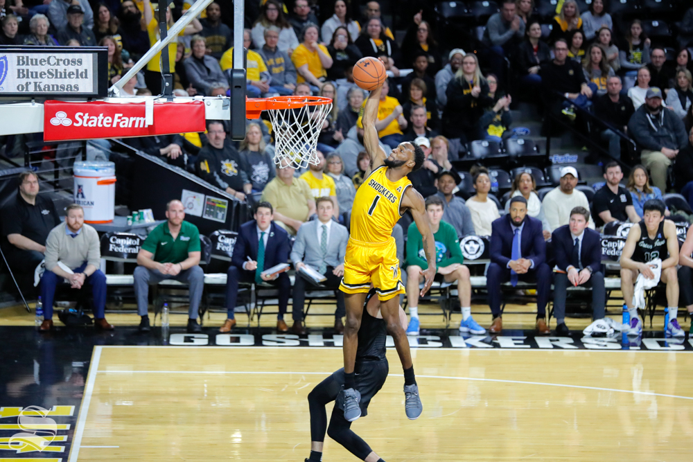 Wichita+State+forward+Markis+McDuffie+dunks+over+a+Tulane+defender+during+the+game+on+Feb.+9%2C+2019+at+Charles+Koch+Arena.+%28Photo+by+Joseph+Barringhaus%2FThe+Sunflower%29.