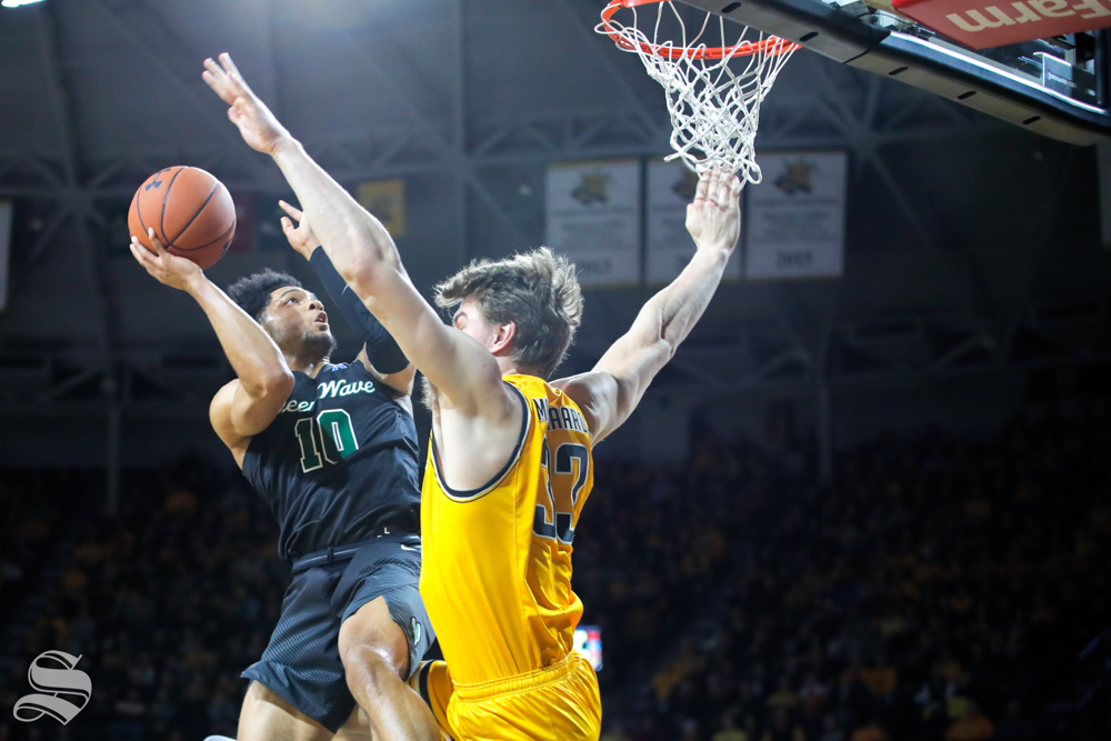 Tulane+guard+Caleb+Daniels+goes+up+against+Wichita+State+center+Asbj%C3%B8rn+Midtgaard+during+the+game+on+Feb.+9%2C+2019+at+Charles+Koch+Arena.+%28Photo+by+Joseph+Barringhaus%2FThe+Sunflower%29.