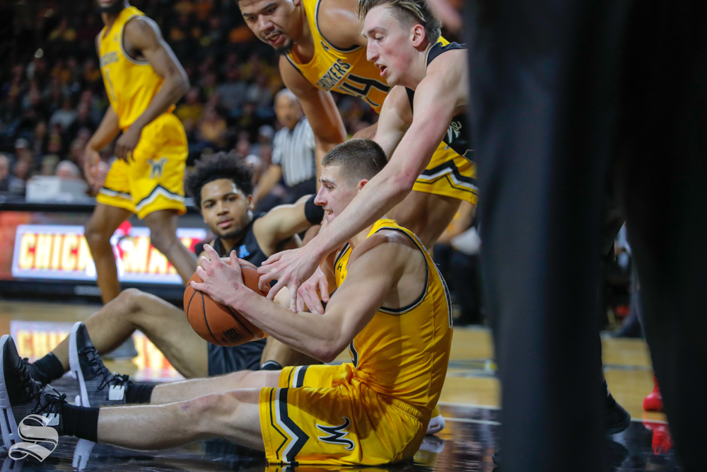 Wichita+State+freshman+Erik+Stevenson+fights+for+the+ball+on+the+ground+during+the+game+against+Tulane+on+Feb.+9%2C+2019+at+Charles+Koch+Arena.+%28Photo+by+Joseph+Barringhaus%2FThe+Sunflower%29.
