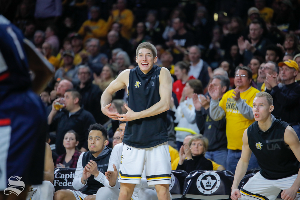 Wichita+State+guard+Jacob+Herrs+celebrates+from+the+bench++in+the+second+half+of+the+game+against+UConn+on+Feb.+28%2C+2019+at+Charles+Koch+Arena.+%28Photo+by+Joseph+Barringhaus%2FThe+Sunflower.%29