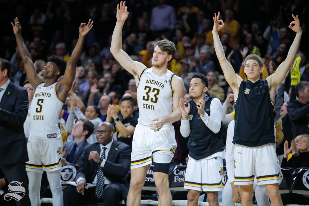 The+Wichita+State+bench+celebrates+after+a+three-point+basket+in+the+second+half+of+the+game+against+UConn+on+Feb.+28%2C+2019+at+Charles+Koch+Arena.+%28Photo+by+Joseph+Barringhaus%2FThe+Sunflower.%29